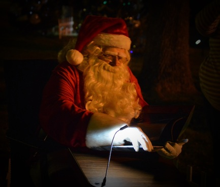 Santa reading the Night Before Christmas at the North Pole Stroll in Athens